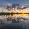Sunset reflection in a pond in the boreal forest in Ontario's Far North.